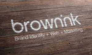 brown-ink-logo-white-paint-on-timber